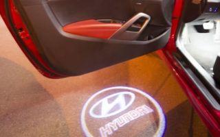 Мегатюнинг — установка проекции с логотипом автомобиля