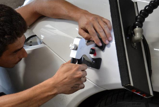Вытягивание вмятин на автомобиле